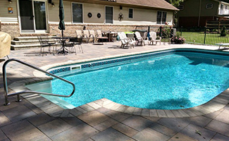 Inground Pool Installation Ann Arbor MI - Hardscape Solutions - in-ground-pool-sunny-day